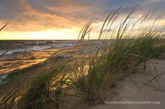 Storm light over Lake Michigan ~ after a day of rain the sun makes a dramatic appearance. Photo by Neil Weaver Photography
