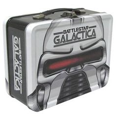 "Battlestar Galactica Cylon Tin Tote by Bif Bang Pow!. $17.97. Dimensions: Approximately 7""H x 8.5""W x 4""D. Officially licensed. One futuristic metal lunch box comin' right up! Don't miss this BSG-themed tin tote! Inspired by the Battlestar Galactica sci-fi TV series. It's perfect for loyal fans and collectors alike! Don't miss this BSG-themed tin tote inspired by Battlestar Galactica! Perfect for loyal fans and collectors alike, the futuristic metal lunch box ..."