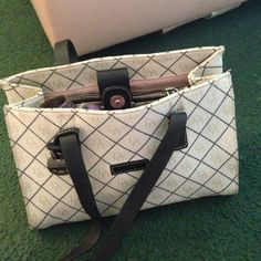 Canvass & leather designer bagsale 1 HR Off white canvass with black stitching & gold DB's printed in canvass. Black leather handles. With gold tone purse protectors on bottom. needs a lite cleaning. No rips or tares. 2 utility compartments. & 2 zip pockets inside. Very nice bag Dooney & Bourke Bags Totes