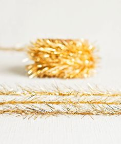 Tinsel Twine in Gold  6 Yards — Thatch & Thistle Supply Co. // Pretty packaging, gift wrapping, crafting and party supplies for gifts, parties, birthdays, showers, weddings and decor. Shop for baker's twine, mini clothespins, paper bags, pom pom garland, paper straws, carnival tickets, specialty twine, stickers and more! // thatchandthistleco.etsy.com