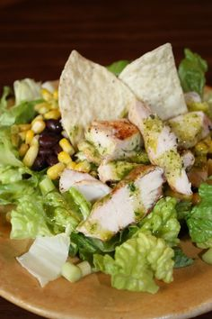 Cuban Chicken Salad ~ The combination of corn, black beans, cilantro and lime make this salad a hit with everyone! It comes together in about 30 minutes for a very fast meal. This is also a great way to use up leftover chicken.   The Happy Housewife