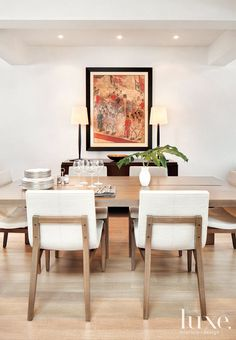 Holly Hunt chairs pull up to a table by Troscan Design + Furnishings in the central dining area. Maxine Snider's walnut Bauhaus console was purchased at Town.
