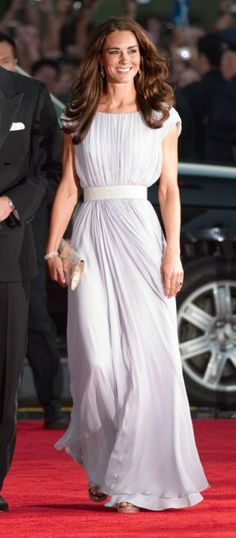 This appearance showed that Kate Middleton—mere weeks after her appearance as a serene bride—could own the world's attention in that most attention-seeking town, Los Angeles. Walking into an L.A. gala held by BAFTA, over which Prince William presides, Kate wore a lavender Alexander McQueen silk-chiffon gown with a spangly white belt, Jimmy Choo shoes, and a metallic clutch.