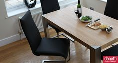 The exclusive Angola Modern Oak Dining table is a beautiful, contemporary top quality oak veneered dining table which is perfect for a modern kitchen or dining room.  The Angola Oak Dining Table has a funky minimalistic design with sharp, smooth straight lines that make it stand out from the huge array of oak tables on the market. The rich oak veneer is enhanced beautifully by the brushed steel frame and legs, which in turn create triangular corner insets to give a funky, modern twist. £229....