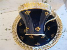 Vintage Aynsley Navy Blue Teacup and Saucer Bone China with Gold Pattern.