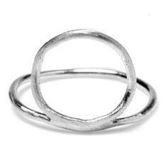 This thin banded ring from Odette Jewelry is adorned with a raised oval in a matte finish, first carved from wax by hand then cast in recycled Sterling Silver.  The Athene Divinus collection by Odette New York is inspired by ancient artifacts and mythologies, divine proportion, and the geometry of anatomy. Made in New York City.