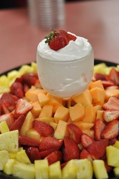 A light and creamy fruit dip that ALWAYS disappears way to fast!  Serve on a fruit platter in a goblet... a touch of elegance to your evening!  Recipe: 6oz Strawberry yogurt 8oz cool whip  Mix and cool in the fridge before serving!