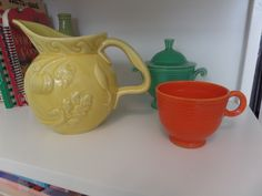 hull pitcher, fiestaware green sugar bowl with lid and orange tea cup