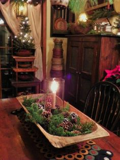 Prim Gatherings...old trencher with pine, cones, & candle...stacked stools with tree.