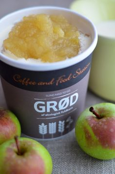 Apple compote with vanilla and pouring cream.