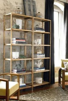 <b>It's basically the Midas touch in a can.</b> DIY Gold IKEA shelving unit