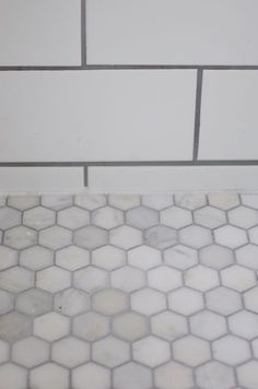 White marble hexagonal tile with grout, Carrera marble floor tile white ceramic tile gray accent Source by LakeyshiaLemane Mosaic Backsplash Kitchen, Hexagon Tile Floor, Subway Tile Showers, Tile Floor, Hexagon Marble Tile, Remodel, Flooring, Subway Tile Shower Designs, Bathrooms Remodel