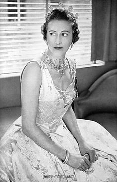 The Countess of Leicester 1953, wearing a tiara featuring five diamond motifs, which bears a resemblance to this earlier pin.  https://www.pinterest.com/pin/532972937127170295/