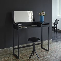 Hellobye Desk or dressing table. Dims: W 100 x D35/44 x H 118/85 cm    Neat space-saving dimensions and on-trend black make this piece very appealing. The top lifts up to reveal a mirror and there is an small tray-drawer to the left