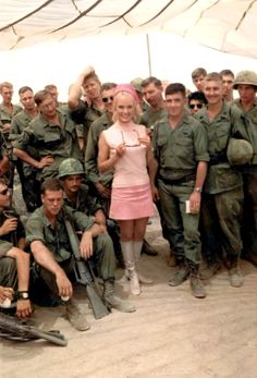 Chris Noel entertaining the troops, anybody know what the troops behind her are looking at...
