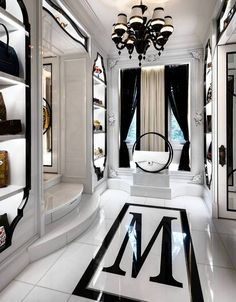 """Sylvia Mantella's black-and-white marble floor includes an """"M"""" bordered in Swarovski crystal, which cost about $12,220. And yes, that is a Chanel hula hoop bag. #luxurybedroom"""