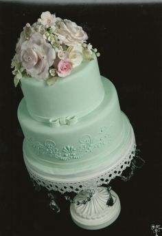 Seafoam Green Cake for Mother's Day - Tone on tone seafoam green cake with gumpaste flowers.