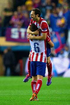 Koke of Club Atletico de Madrid and Juanfran of Club Atletico de Madrid celebrate victory during the UEFA Champions League Quarter Final second leg match between Club Atletico de Madrid and FC Barcelona at Vicente Calderon Stadium on April 9, 2014 in Madrid, Spain.