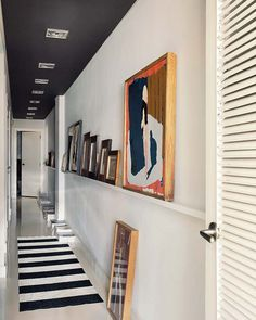 Long narrow hallway with black ceiling and pictures on a flat shelf . Long narrow hallway with black ceiling and pictures on a flat shelf Hallway Walls, Hallway Wall Decor, Hallway Ceiling, Entryway Decor, Entryway Lighting, Entryway Ideas, Hotel Hallway, Upstairs Hallway, Hallway Furniture