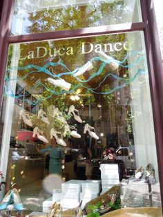Hang dance shoes and ribbons in the window, like La Duca does at their NY store