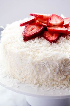 A delicious and moist strawberry coconut cream cake with an amazing coconut cream cheese frosting! I love the flavor combination ...
