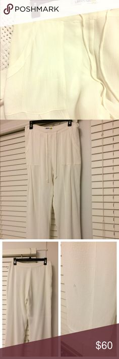 White Silky Pants White HOT silky pants with lining. They're a I Aggie boyfriend fit with a drawstring. Big pockets in the front. Small mark on right front bottom (see pic) it may come out but they're freshly dry cleaned and may not? 98% Viscose and 2% spandex. Only worn 2x. Dry clean or machine wash cold. Wonderful for a relaxing beach dinner! LIBERTY SAGE Pants