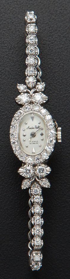 A gorgeous Andre Pailet white gold and diamond wristwatch, with diamonds around the bezel and the top and bottom lugs.