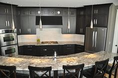 Dark cabinets with light granite