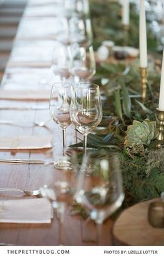 Wooden and green wedding table decor with desert roses | Photo by Lizelle Lotter