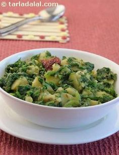 Aloo palak is a very easy and simple recipe with a combination of cubed potatoes and chopped spinach cooked with masalas and red dry chillies. Serve this subzi hot with rotis or parathas.