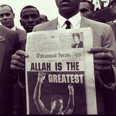 """Muhammad Ali Holding Up Newspaper With the Headline """"Allah is the Greatest"""" From the Collection: Photos of Muhammad Ali (American Muslim Boxer)Originally found on: trueguidance"""