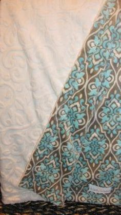Cream vine embossed and aqua damask print minky baby blanket. $45.00, via Etsy.