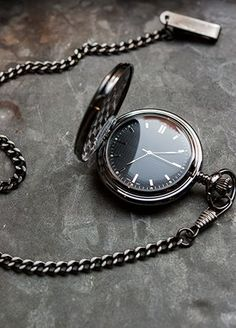 "This classic pocket watch has been given a contemporary twist with its stylish gunmetal finish and sleek watch face. A sentimental gift to thank the best man, father of the groom, father of the bride, groomsman, or usher for being a part of your special day. Features and Facts:   Measures:  Face of watch: 2"" D. Chain: 12"" L.  Material:  Metal Alloy."