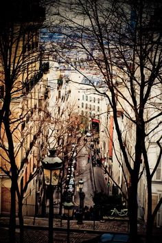 Paris. Montmartre. Must stroll through and see the artists, the cemetery, and photograph the famous stairway