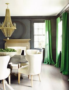Beautiful zinc table, slate walls and jade draperies - perfect and warm!