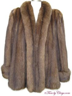 SOLD! Sojuzpushnina Russian Sable Swing Jacket #RS683; Excellent Condition; Size estimate: Misses 10 - 18. This is a gorgeous genuine natural Russian sable fur jacket in the popular swing style. It features a shawl collar, deep turn-back cuffs with fur on both sides so they may be let down if needed, and lightly padded shoulders.  It closes with hooks and eyes. There are many silvery tips, which is one indication of high quality sable fur. This Russian sable jacket is top quality! Regal!
