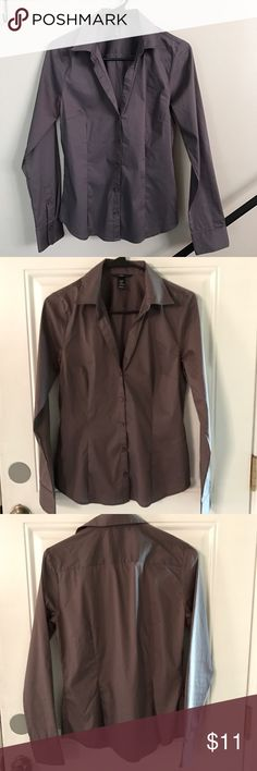 "Brown button down long sleeve shirt This brown long sleeve button down shirt is great for work or anything casual.  Wear with layers or alone.  Buttons start 6"" below neckline.   Does not close at collar.   Nice brown tone size (8) made by H&M. H&M Tops Button Down Shirts"