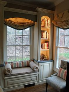 Great window seat (small chat area) with lighted built-in shelves and fluted woodwork. Good lighting.
