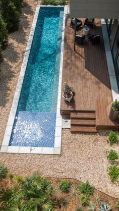 The use of a small lap pool helps break up the back yard and the colours used on house and garden design.[Original:Lap pool for a small yard] Backyard Pool Designs, Small Backyard Pools, Small Pools, Swimming Pool Designs, Outdoor Pool, Outdoor Spaces, Backyard Ideas, Backyard Landscaping, Landscaping Ideas