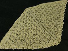 There are two patterns here for a triangular lace shawlette and full size shawl knit from the center back downward. Each pattern has a different border.