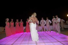 First dance photo. Light up dance floor outdoor reception. Bridesmaids groomsmen.