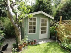 Shed colour! Keops cabin - Cuprinol Garden wood shades in Willow and Natural Stone Painted Garden Sheds, Painted Shed, Wooden Garden, Outdoor Storage Sheds, Outdoor Sheds, Cuprinol Garden Shades, Craft Shed, Wendy House, Shed Colours
