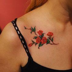 Elegant Camellia Tattoo by nandotattooer
