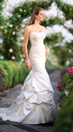 Beautiful mermaid style wedding dress. I mean, I'm not getting married, but that's a beautiful dress.