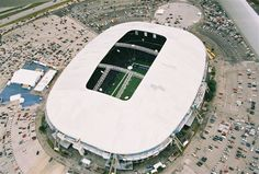 Old Dallas Cowboys Stadium :).  they blew it up a few years ago.  The hole in the roof is so that God can watch his Cowboys.  Dont believe me, ask anyone from Texas.