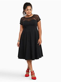 "Fact: you can never go wrong in a black dress. The woven sweetheart bodice and flared skirt are ultra stretchy, keeping you as comfy as possible while you dance the night away. The mesh inset on the scoop neck and v-back show off some skin without getting scandalous.<div><br></div><div><b>Model is 5'10"", size 1<br></b><div><ul><li style=""LIST-STYLE-POSITION: outside !important; LIST-STYLE-TYPE: disc !important"">Size 14 measures 44"" from shoulder</li><li style=""LIST-STYLE-POSITION..."