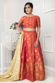 Fashion and trend will be on the peak of your attractiveness when you attire this orange art silk lehenga choli. This pretty dress is displaying some extraordinary embroidery done with weaving work.Largest selection of lehenga choli from popular indi Indian Lehenga, Silk Lehenga, Bridal Lehenga, Orange Lehenga, Choli Designs, Blouse Designs, Lehenga Choli Online, Half Saree, Indian Outfits