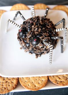 Combine black olives, mozzarella + cream cheese to make this Halloween party dip.