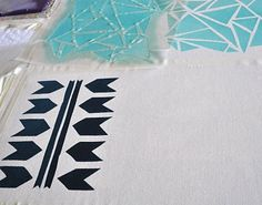 print your own fabric using stencil techniques with household objects and contact paper