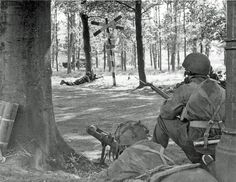 Men of HQ Troop of 1st Airlanding Brigade Reconnaissance Squadron at Wolfheze on the outskirts of Arnhem, 18 September 1944. The man on the left is manning a PIAT. 18 September 1944 (Imperial War Museum)